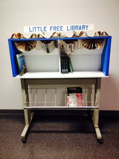Bill Knoblauch. Hancock, MI.   This is the second little free library designed by a Finlandia University student. Gina Paulson envisioned an original design for an indoor Little Free Library Unit that re-purposed materials. The unit is currently housed in the Jutila Center for Global Design and Business.