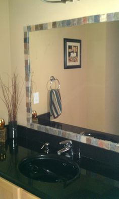 Latest pinterest project complete! I tiled our plain mirror!