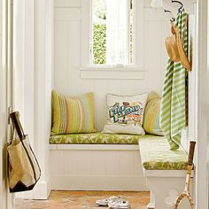 Custom benches open up for storing sports equipment, while hooks are perfect for hanging beach towels and hats in this coastal cottage. | Photo: John Ellis | thisoldhouse.com