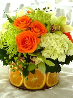 Lovely flowers with oranges..
