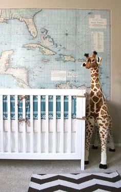 nursery: crib, map, giraffe...I actually love the map idea!