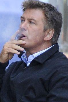 Alec Baldwin smoking a cigarette (or weed)