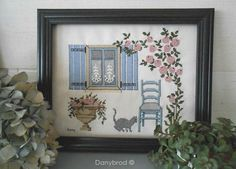 Embelishment idea,   1989  I started the embroidery on Aida fabric, as certainly many beginners embroiderers.  At that time, cats were already part of our family!  I dressed windows with small pieces of old lace.