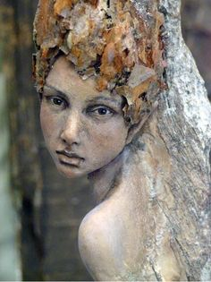 by Tatjana Raum. [Image #7 of Week: Sept 16th - 20th]  I'm not sure if this is a painting or a sculpture, and if it's a sculpture, then I love the realism of the piece. It seems to me, like a life-sized wood fairy. The realism, makes me question if fairies are real.