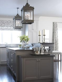 Amazing kitchen lighting HGTV's Sarah Richardson's home. See more: http://www.hgtv.com/on-tv/sarahs-suburban-house-new-home-classic-style/pictures/page-14.html?soc=pinterest