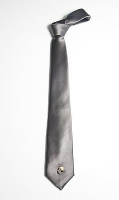 So sexy - 14kt gold skull amulet on a grey silk satin tie. #50ShadesofGrey  via TitleofWork.com