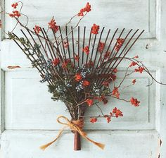 Decorate an old rake insted of a door wreath ~ great idea!  Great for my garden gate.