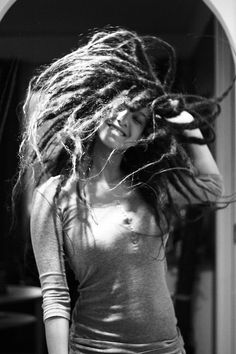 Girl with dreadlocks dancing black and white photo