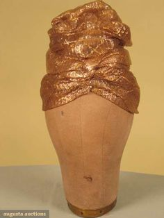 Augusta Auctions, November 2009 Museum Fashion & Textile Sale, Lot 108: Lilly Dache Gold Cellophane Turban, 1930s