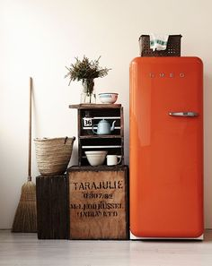 An autumn orange SMEG refrigerator. We wish we could have one in every color.