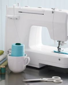 a way to use large spool of thread on a standard machine. . ..