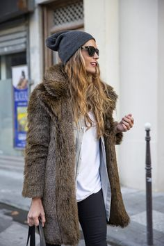 fur coat + beanie cool look, ,maybe a different fitted jacket or sweater...