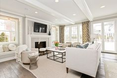 Suzie: Refined LLC - Transitional living room with wood beams painted glossy white, gray walls ...