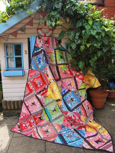I love the quilt and the shed