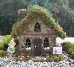 Gnome House - i love the moss roof, stone trim in front, shape of windows with inset hardware cloth, wood trim, window boxes, stone chimney - very cute house!  ********************************************  Kaboodle - #fairy #garden #gardens #miniature #miniatures #fairies #whimsical #whimsy #house - tå√