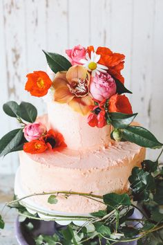 peach cake with bright flowers #wedding peach cake, cake flowers, color, simple cakes, wedding cakes, fresh flowers, bird of paradise, tropical weddings, floral