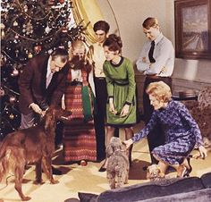 Left: King Timahoe receives a dog treat from President Nixon for the holidays. King is named after a village in Ireland.