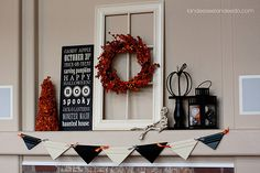 Great use of an old window pane and cute subway art, halloween style