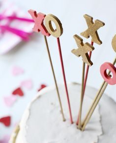 DIY Glittered Cake Toppers by Courtney Whitmore of Pizzazzerie