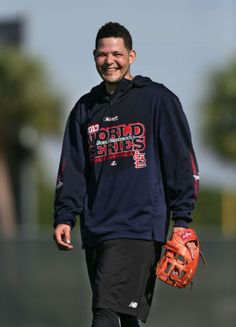 catcher Yadier Molina jokes around with his teammates during a workout in the Cardinals complex 2-12-14