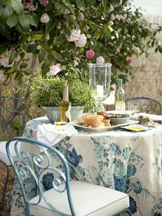 Clarence House linen. Jasmine in 19th century bowl. Vintage French chairs. Garden Dining.