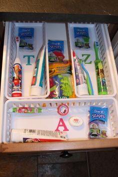 My kids dental organization. No more touching toothbrushes and germs! I cut out their initials in vinyl with my Cricut in their favourite colour. A place for everything and everything in its place.