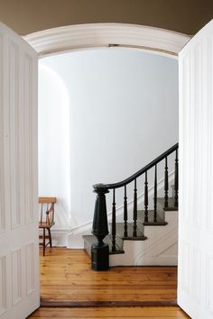 """""""We painted our banister in Benjamin Moore's Black Beauty, a black I love because of its softness (it's mixed with white so it's not a pure black) and it feels appropriate for an old house."""" Quote & home by designer Lena Corwin, Brooklyn. via Remodelista"""