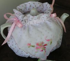 A tea cozy from vintage hankies...love it!   *** this sounds like something you would luvvvvv ***