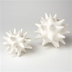 Or maybe these (Global Views White Ceramic Urchin Object, via Zhush)