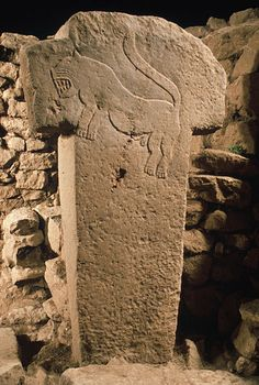 T-shaped pillar with carving, of 11,000 year old Gobekli Tepe, Turkey.