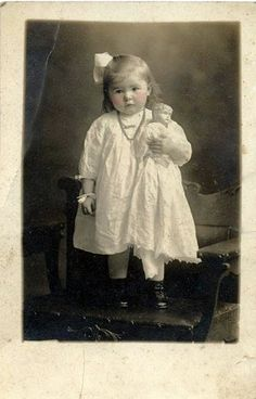 vintage photo of girl with doll