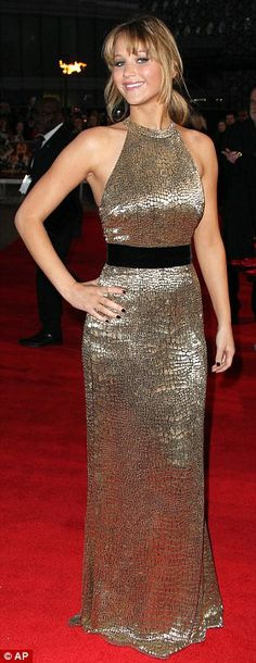 All that glitters: Jennifer Lawrence shimmering in a gold Ralph Lauren dress at the London premiere of Hunger Games today!