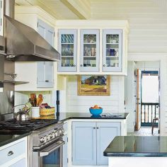 Cream cabinets envelop light blue cabinet doors and drawers for a crisp, bright kitchen. | Photo: Deborah Whitlaw Llewellyn | thisoldhouse.com blue accent, cottage style kitchens, painted kitchens, kitchen idea, color blue, blue kitchens, cabinet doors, blues, painted kitchen cabinets