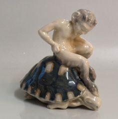 http://www.jamerantik.dk/royal_copenhagen_faun.htm 1880 Pan på skildpadde Knud Kyhn 1917 13 x 13 cm (now in english- 1880 Faun on tortoise Knud Kyhn 1917 13 x 13 cm)