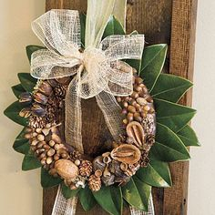 Acorn Wreath | Dress up your dining chairs for the season. Collect small acorns, nuts, and other items from the yard and attach them to a wreath form that is wrapped in a chocolate brown ribbon. | SouthernLiving.com