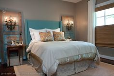 """""""chipping paint"""" vintage doors flanking the bed were found at an antique mart (colors of the room were taken from the turquoise found in the doors)  sconces mounted on them to create """"side amps"""" over the drop-leaf side tables.  A perfectly proportioned headboard was custom made for the spot -- guest bedroom designed by Lyndon West (image via Cote de Texas)"""