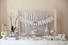 Elegant gray baby shower dessert table and backdrop!  See more party planning ideas at CatchMyParty.com!