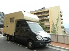 Unique double-cab Mercedes Sprinter camper, with fiberglass expedition-style camper shell. From the German Sprinter Forum.