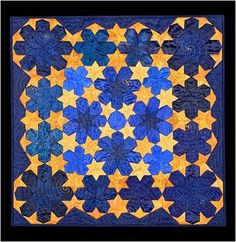 Starshine, 29 x 29, by Helen Remick.  Every element forms a star within a tessellating design. Posted at Quilt Inspiration