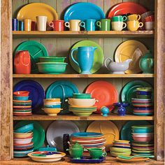 love me some #fiestaware.  This is perfect for my house.  Bright Dish Display    Got a colorful collection? Display it on a more neutral shelf that won't distract.