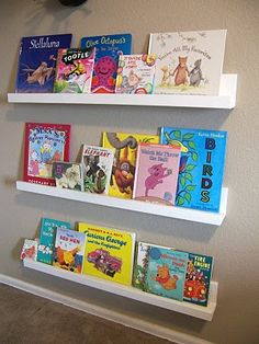 I want to make sure when I have kids that they have a bookshelf like this so they can see all their books and love reading and then maybe put a big comfy chair or corner filled with pillows for them to read in.