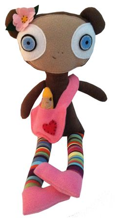 """""""Molly"""" Monkey, by designer Leann Leftwich Zajas and sold exclusively by the Peabody Essex Museum. This plush doll is quite big and comes with her own satchel and her own little doll tucked inside. She also has a twin brother, """"Olly"""" - $30"""