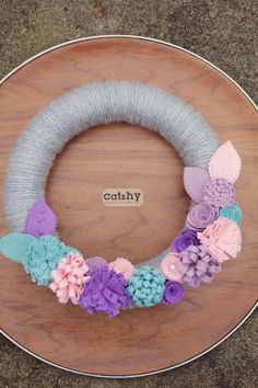 Yarn wrapped Spring Wreath to hang on baby girl's door