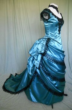 Victorian Style Bustled Ball Gown in Teal Satin with Black Lace. $595.00, via Etsy.
