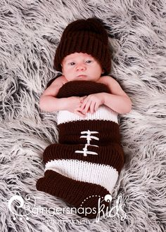 Sports fans will appreciate this football-inspired knit baby cocoon.  Knit a matching hat to complete the look!