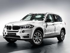 BMW Showed Off Its Armored SUV By Attacking It With A Machine Gun - Business Insider