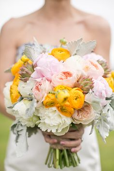 Pink and yellow peony and ranunculus bridal bouquet | Heidi Geldhauser of Our Labor of Love | Brides.com