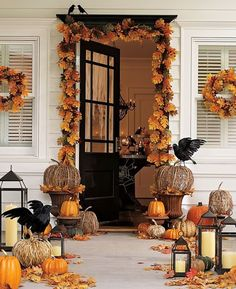 Black front door with great fall decor like crows