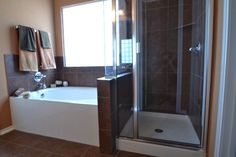 Large garden tub with seperate shower in the master bath.