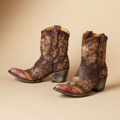 """NENA BOOTS BY OLD GRINGO--Handmade by Old Gringo in distressed, crackled leather, starflower embroidered above a studded toe. 2-3/4"""" stacked heel. Imported. Whole and half sizes 6 to 10, 11.View our entire Old Gringo Collection."""